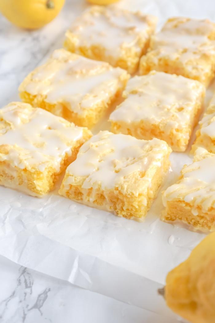 Glazed Lemon Brownies on Parchment Paper