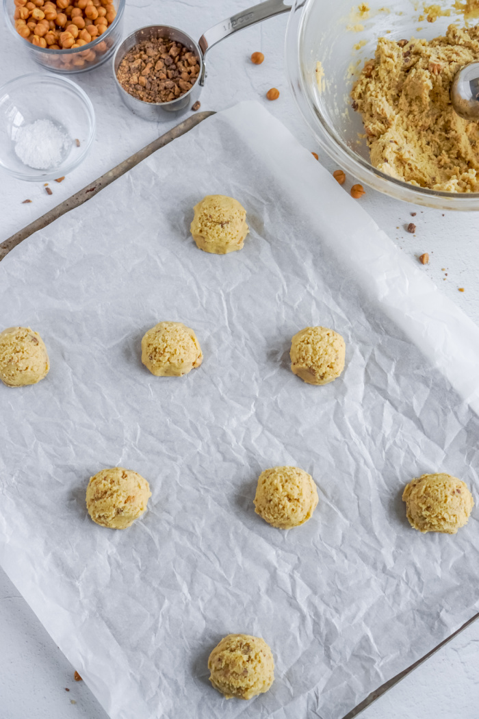Cookie dough balls on cookie sheet