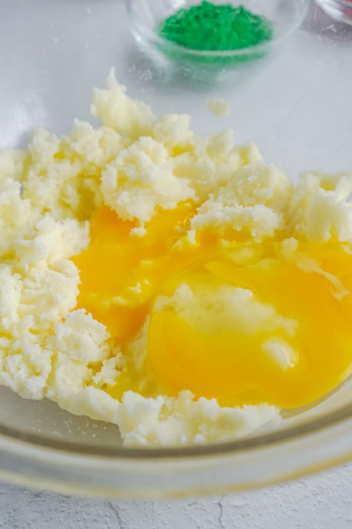 Egg and egg yoke added to bowl