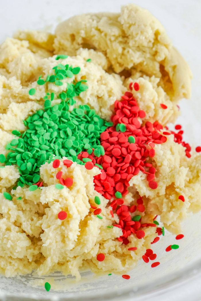 Red and green sprinkles added to dough